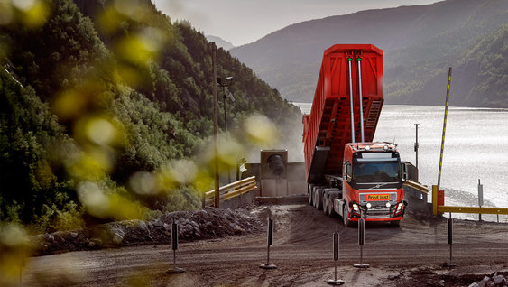 Autonomous Volvo FH truck operating in limestone mine.
