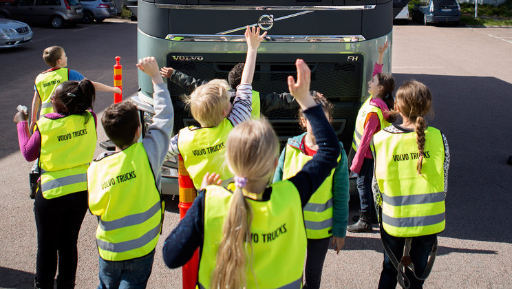 "Children in southern Finland on the road safety course ""Stop, Look, Wave""."