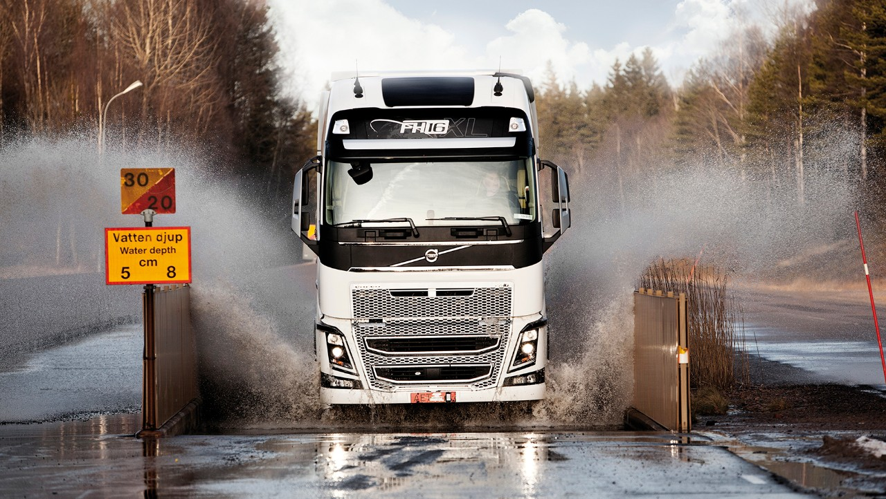 Volvo FH driving through water