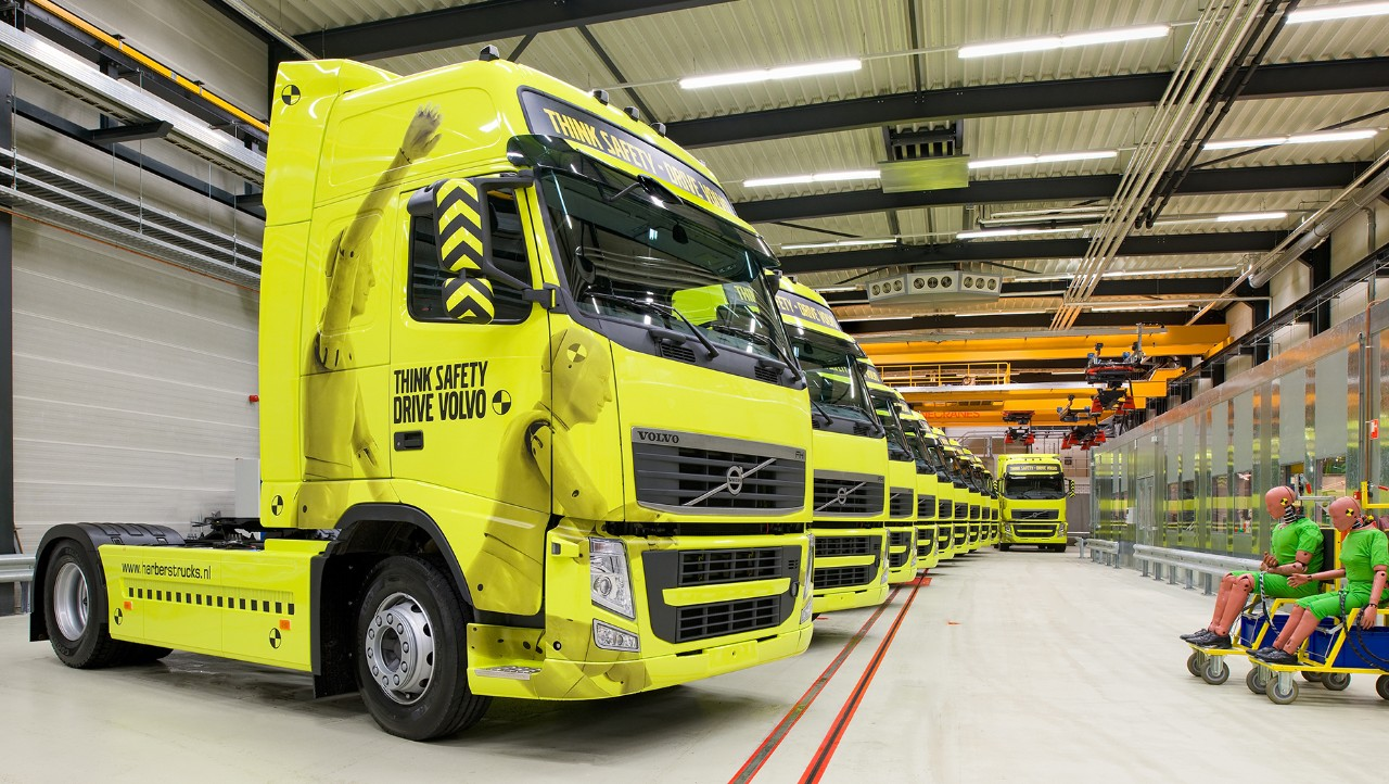 Several yellow Volvo FH set next to each other
