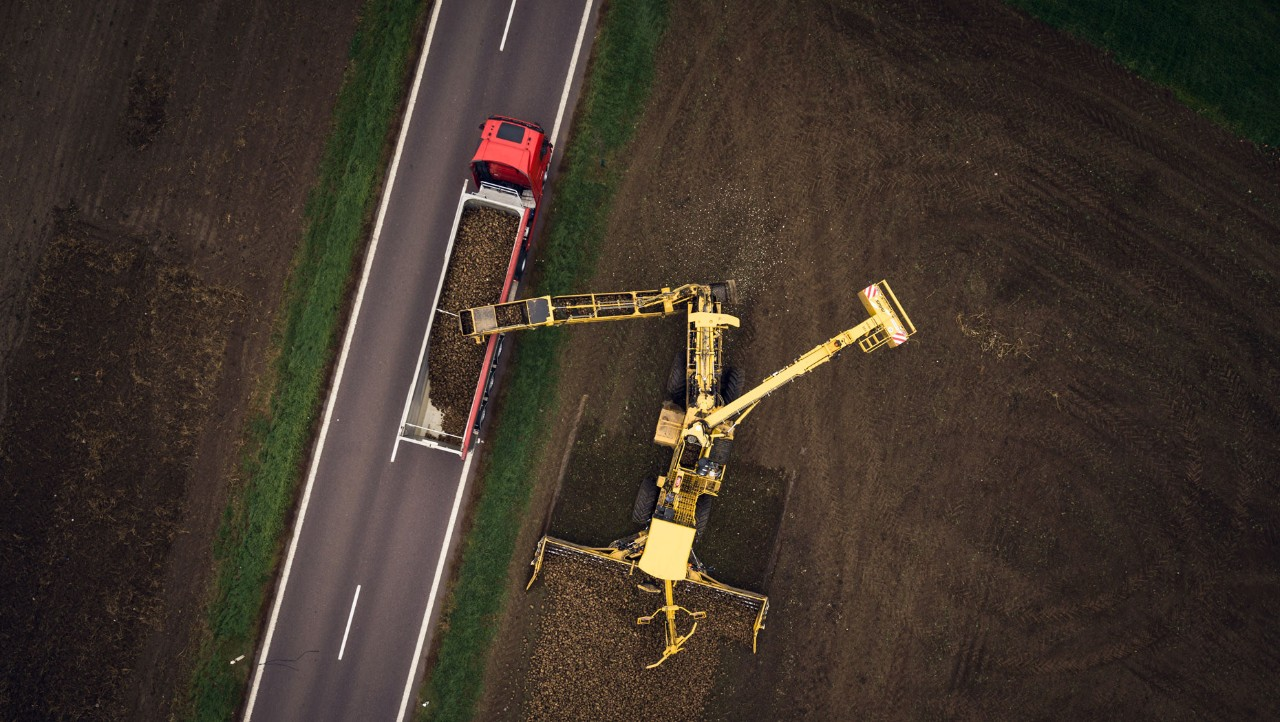Aerial view of a truck being loaded with sugar beet