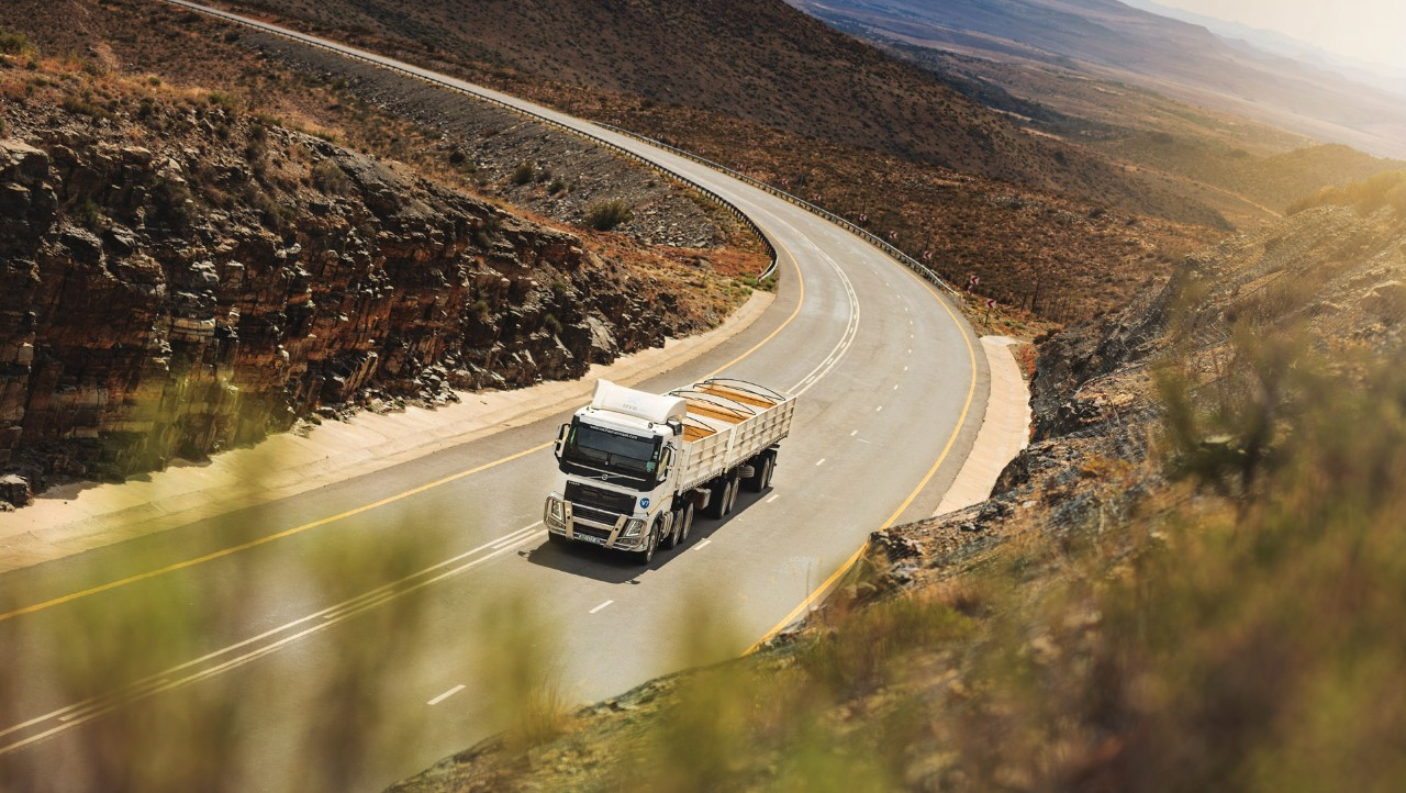 A Volvo FH drives through a dry South African landscape