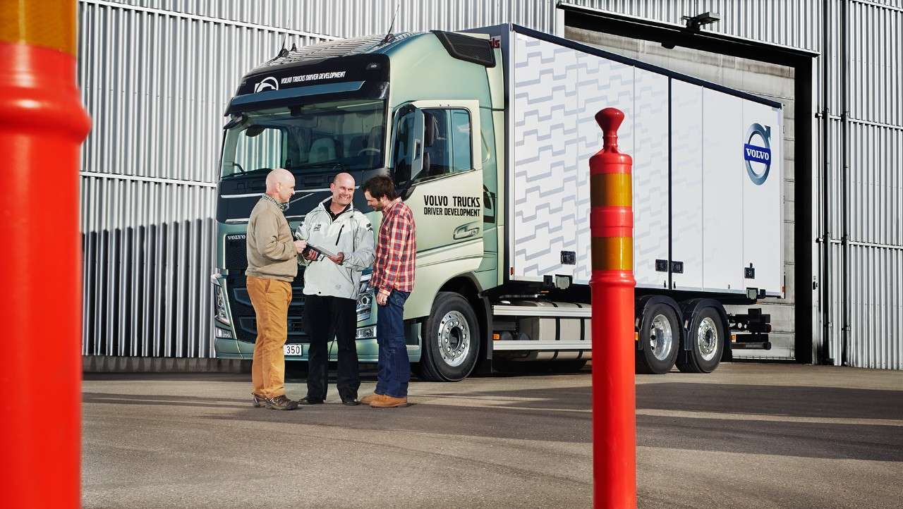 Volvo trucks training overview people in front of truck